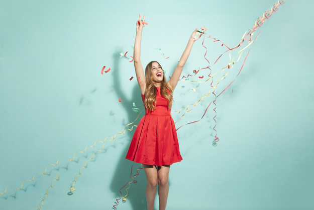 young-girl-dancing-with-confetti_freepik